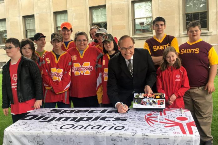 City of Peterborough Mayor Daryl Bennett with some student atheletes on Special Olympics Day in Peterborough (May 22, 2018). Hosted by the Peterborough Police Service, the 2018 Special Olympics Ontario School Championships takes place from May 29th to 31st in Peterborough. (Photo: Special Olympics Ontario)
