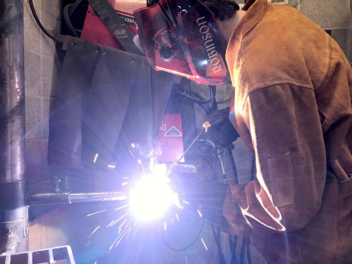 Students like Owen, shown here welding, owe their success to experienced instructors at the Whitby Trade Centre like William Joy, who has been a welder for 40 years.  (Photo: Galen Eagle / PVNC Catholic District School Board)