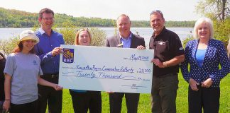 City of Kawartha Lakes staff and council members joined Kawartha Conservation and RBC staff for a cheque presentation on May 24, 2018, at the Omemee Beach. Pictured are: Emily Johnston, Kawartha Conservation Stewardship Outreach Technician; Mark Majchrowski, Kawartha Conservation CAO; Nancy Lee, RBC Group Services Representative; Doug Richardson, RBC Lindsay Branch Manager; Andy Letham, Mayor of the City of Kawartha Lakes Mayor; and Mary Ann Martin, Kawartha Lakes Ward 15 Councillor. Not pictured: Jenn Johnson, City of Kawartha Lakes Parks, Recreation and Culture Division Manager; Kristie Virgoe, Kawartha Conservation Director of Stewardship and Conservation Lands; Mike Goodhand, Kawartha Lakes Area Parks Supervisor. (Photo courtesy of Kawartha Conservation)