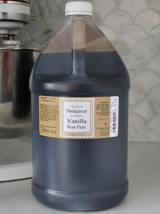This gallon jug (3.79 L) of Madagascar vanilla bean paste, which would flavour around 96 gallons of vanilla ice cream, costs $510.  This is significant cost for smaller ice cream factories, which might produce several hundred gallons of ice cream in a day.