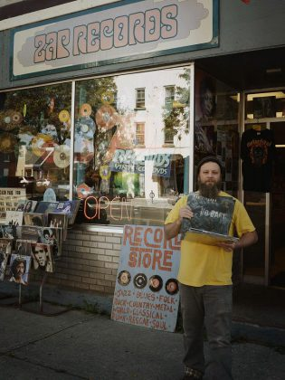 Owner Tim Horgan pictured in front of ZAP Records at its previous 14 King St. E. location. Horgan, who opened his independent record store in 1991, moved to a larger location at 45 King St. E. in 2016. He is now opening a second location in downtown Peterborough. (Photo: Ray Kies)
