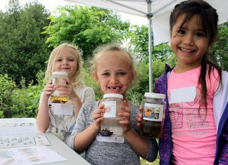 Students attending this 2018 Peterborough Children's Water Festival hold up their favourite invertebrates. The Otonabee Conservation activity centre allows children to get up close with many aquatic bugs and insects to understand how their unique features allow them to live in water. This year's festival, which took place on June 6th and 7th, had registration numbers. (Photo: Karen Halley / GreenUP)
