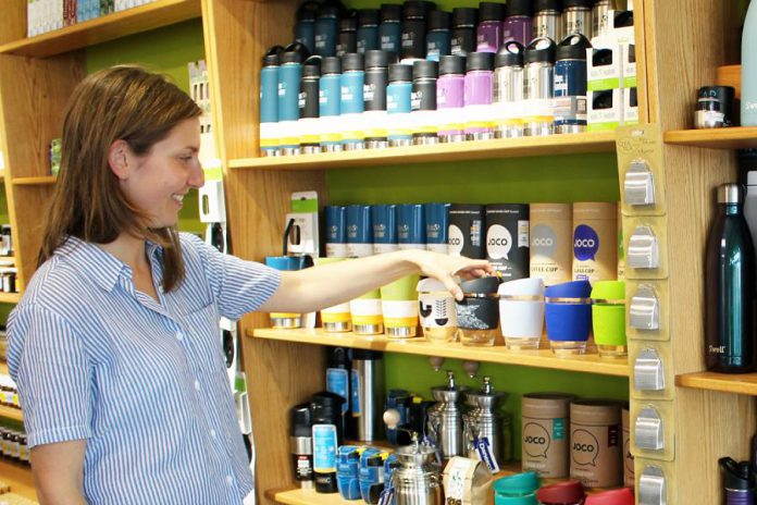 GreenUP Store Coordinator Kristen Larocque with the many non-disposable and reusable products available at the GreenUP Store to help you have a zero-waste picnic or outing. (Photo: GreenUP)