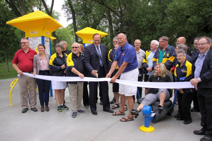 Peterborough Kawarthas Rotary Club president Len Lifchus, City of Peterborough Mayor Daryl Bennett, and incoming Peterborough Rotary Club president Ken Tremblay cut the ribbon officially opening Peterborough's first outdoor adult gym on June 13, 2018 at Beavermead Park.  (Photo: Jeannine Taylor / kawarthaNOW.com)
