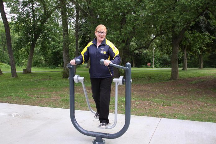 Rotary club member Donna Geary tries out a piece of the equipment. (Photo: Jeannine Taylor / kawarthaNOW.com)