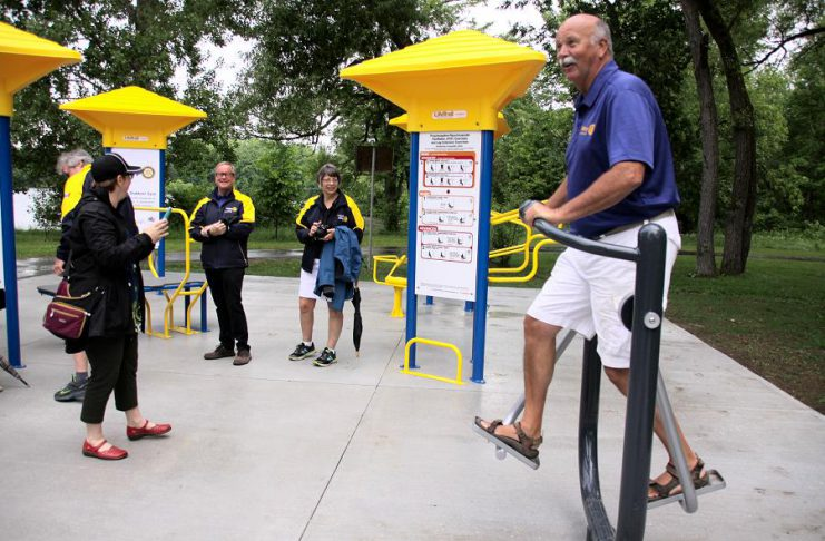 Ken Tremblay, incoming President of the Rotary Club of Peterborough, tries out a piece of equipment at Peterborough's first adult outdoor gym at the official opening on June 13, 2018 at Beavermead Park. The Rotary Club of Peterborough and the Rotary CLub of Peterborough Kawartha each contributed $25,000 to the gym's construction, with the City of Peterborough contributing $40,000. (Photo: Jeannine Taylor / kawarthaNOW.com)