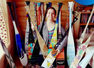 """Some of the 70 uniquely painted wooden canoe paddles that will soon be showcased on poles on the main streets of Bobcayeon, as part of the """"Vibrant Village"""" efforts organized by Impact 32, a volunteer steering committee made up of local business owners and community organizers in Bobcaygeon. (Photo: Kawartha Mediums)"""