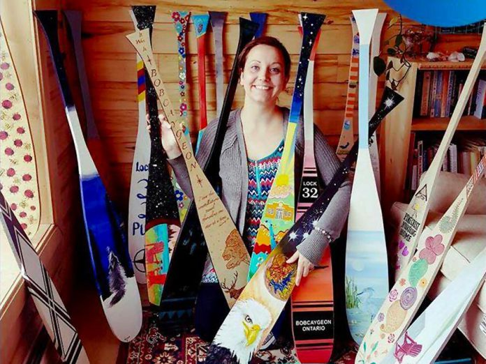 "Some of the 70 uniquely painted wooden canoe paddles that will soon be showcased on poles on the main streets of Bobcayeon, as part of the ""Vibrant Village"" efforts organized by Impact 32, a volunteer steering committee made up of local business owners and community organizers in Bobcaygeon. (Photo: Kawartha Mediums)"