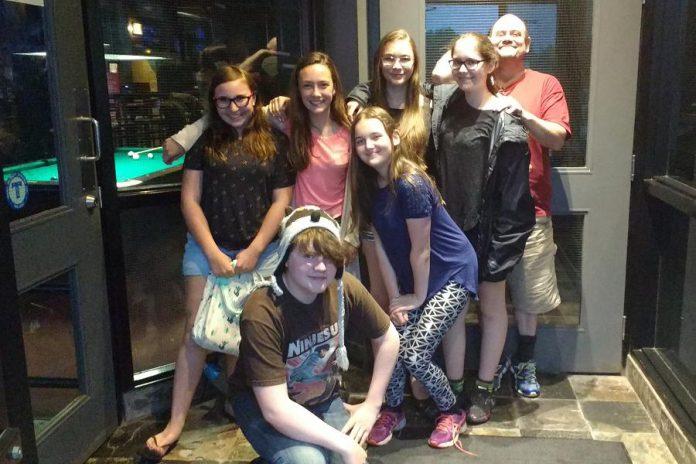 "The cast of ""Boy Wonders"" off stage: Emily Keller, Abbie Dale, Aimee Gordon, Samuelle Weatherdon, Brad Brackenridge, Emma Meinhardt, and Tyrnan O'Driscoll. (Photo: Sam Tweedle / kawarthaNOW)"