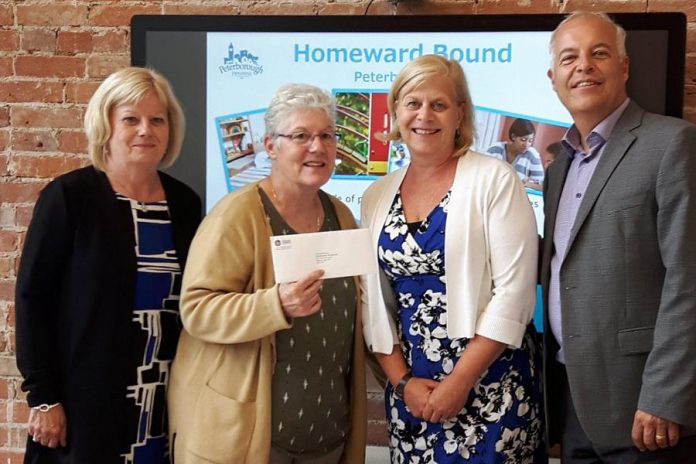 Peterborough Housing Corporation CEO Darlene Cook and Homeward Bound manager Marnie Watson receive a cheque for $20,000 from Community Foundation of Greater Peterborough board chair Diane Richard and executive director John Good. Led by Peterborough Housing Corporation, Homeward Bound helps inadequately housed or homeless mother-led families achieve self-sufficiency. (Photo: Community Foundation of Greater Peterborough)
