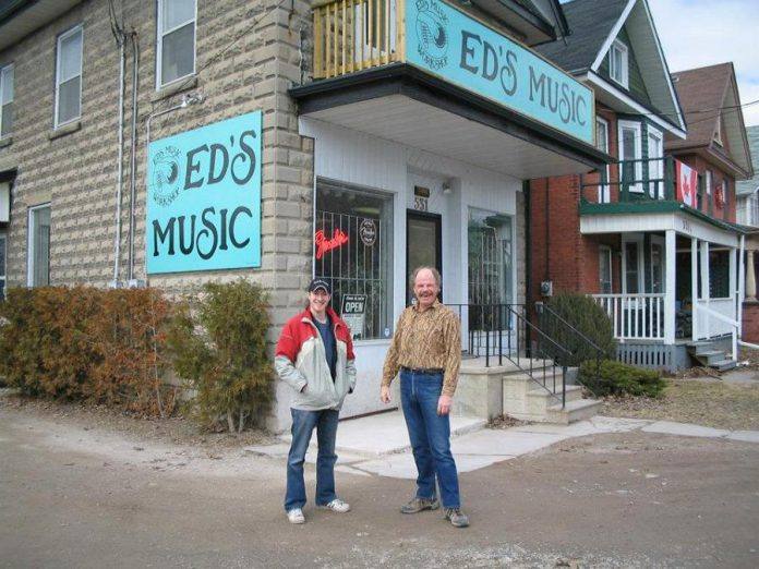 Musician Paige Armstrong with Don Skuce in 2002 at Ed's Music in Peterborough. (Photo: Paige Armstrong / Facebook)