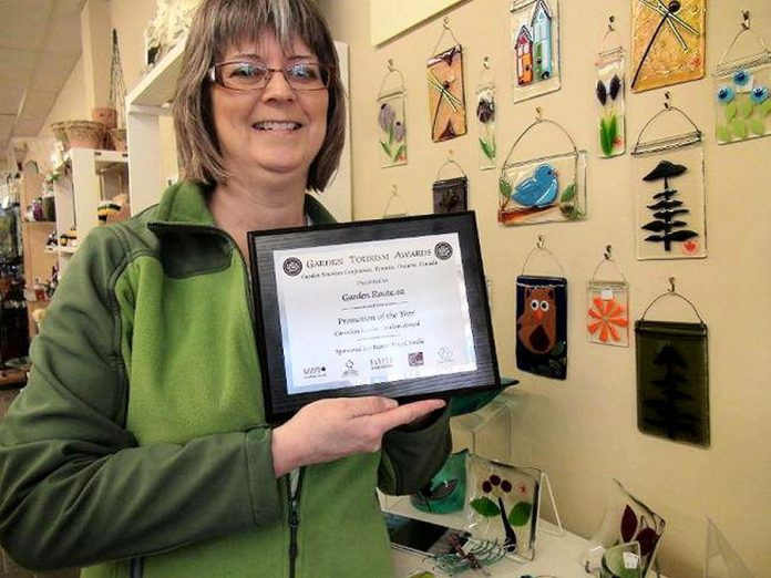 Brenda Ibey, owner of The Avant-Garden Shop, in 2013 displaying the Promotion of the Year award for GardenRoute.ca from the National Garden Tourism Conference. (Photo courtesy of Peterborough and Area Garden Route)