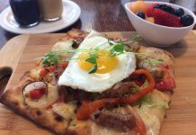The Monaghan Café in Peterborough is under new ownership. A new menu offers fresh new options like the Sunny Up Pizza, a breakfast pizza with fresh herbs and a sunny-side up egg. Food is made from scratch and served with a bowl of fruit and homemade peanut butter, jam, and ketchup. (Photo: Eva Fisher / kawarthaNOW.com)
