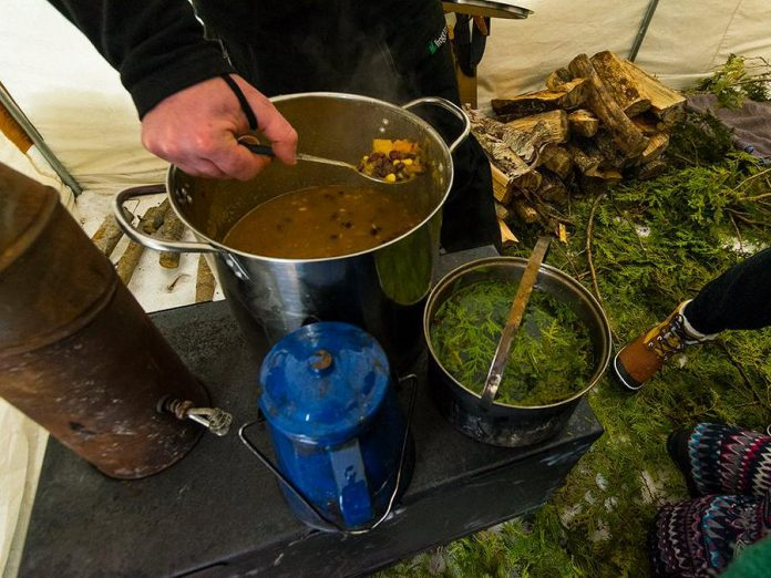 The Land Canadian Adventures offers culinary courses that enable you to eat well in the backcountry. Food on a trip can use traditional and even wild ingredients, like this meal of Three Sisters Stew and Cedar Tea. (Photo: The Land Canadian Adventures)