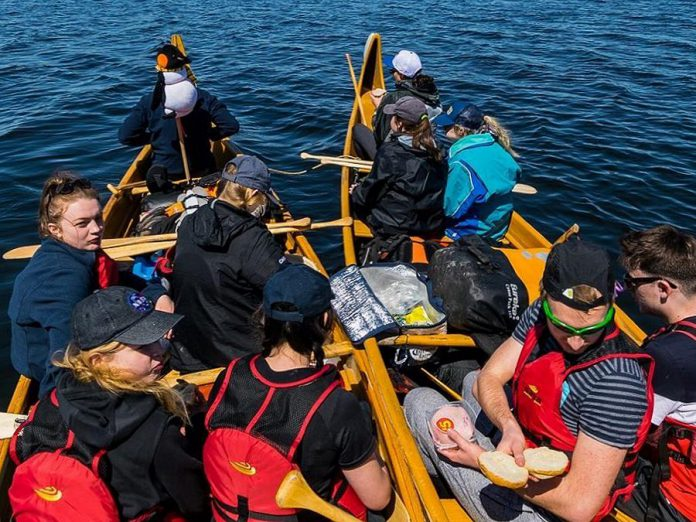 On a trip it's important to make sure your nutritional requirements are being met. That can mean stopping mid paddle for a quick snack break. (Photo: The Land Canadian Adventures)