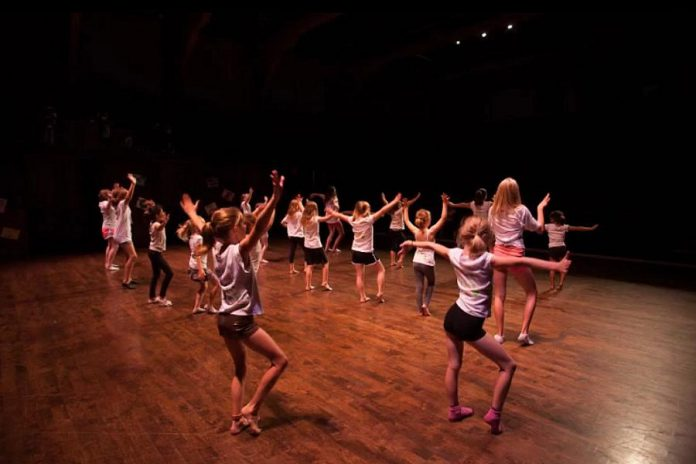 Shannon Stanlick's Triple Threat Dance Camp combines acting, signing, and dancing onstage. Children also take part in a variety of choreographed and directed musical theatre numbers. (Photo: Bradley Boyle / Market Hall Performing Arts Centre)