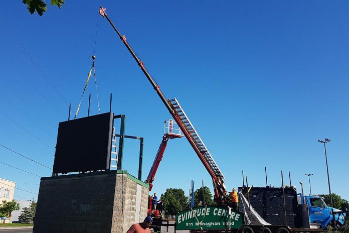 A crew installing two Movingmedia digital billboards at the Evinrude Centre in Peterborough. (Photo courtesy of Movingmedia)