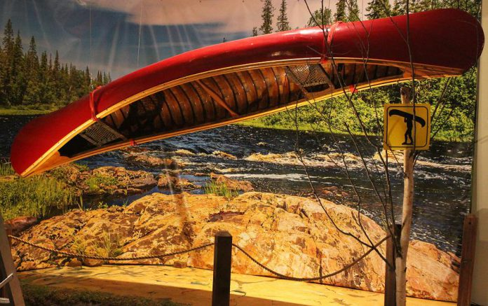 "The 'Just Add Water: Little Boats with Big Stories' exhibit will include a photo booth where you can take a photo of yourself ""portaging"" this suspended canoe to post on social media.  (Photo courtesy of The Canadian Canoe Museum)"