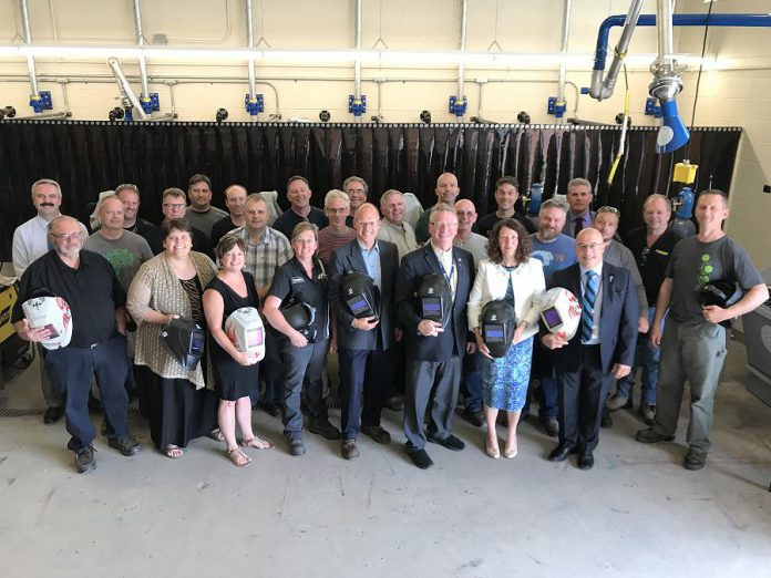 Attendees at the June 26, 2018 media conference celebrating the new $650,000 investment in the Peterborough Victoria Northumberland and Clarington (PVNC) Catholic District School Board's welding program. PVNC director of Education Michael Nasello (pictured in the front row, far right) praised the announcement as a significant advantage for students to receive much-in-demand welding skills while still attending high school. (Photo courtesy of Galen Eagle / PVNC)