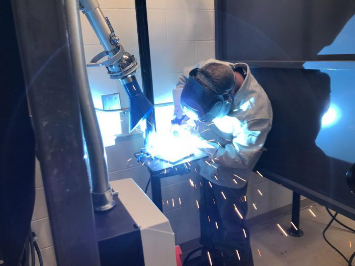 As part of a $650,000 investment in Peterborough Victoria Northumberland and Clarington Catholic District School Board's welding program, the board's six secondary schools located in Peterborough, Cobourg, Lindsay, and Clarington are being equipped with state-of-the-art welding booths thanks to partnerships with the CWB Welding Foundation, which funded nearly half of the project, as well as McCloskey International for its donation of all 36 welding booth structures. (Photo courtesy of Galen Eagle / PVNC)