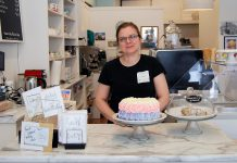 "Carmela Mangos, co-owner of Sugar Dust Bakery & Cafe, and her husband George have launched a ""pay-it-forward"" meal program where customers can buy lunch for a person in need. Unlike similar pay-it-forward programs, the Mangoses provide customer-purchased meal vouchers to local community organizations who identify people to receive the free meal. (Photo: April Potter / kawarthaNOW.com)"