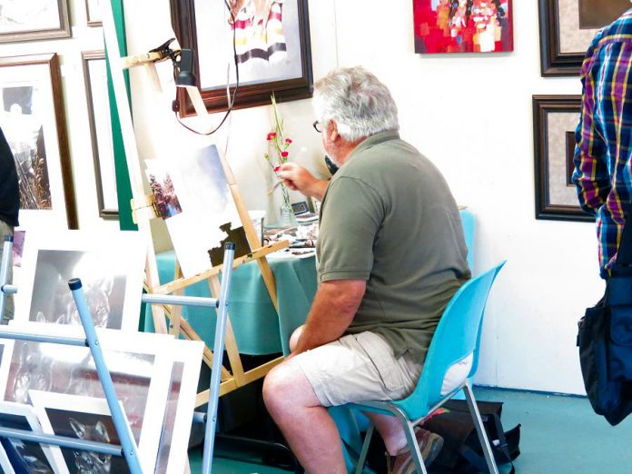 Artist Eddie LePage an alumni artist who has been with the Buckhorn Fine Art Festival since itse beginnings; he was one of the artists who built the galleries in Festival Park. (Photo courtesy of Buckhorn Fine Art Festival)