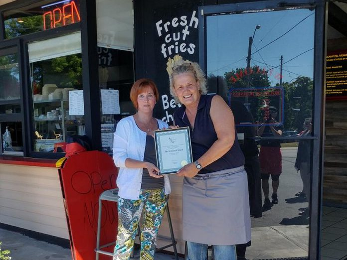 Heather Norris, President of Port Hope and District Chamber of Commerce, congratulates owner Anja Rohlfs on the opening of The Schnitzel Shack in Port Hope. (Photo: Port Hope and District Chamber of Commerce / Facebook)