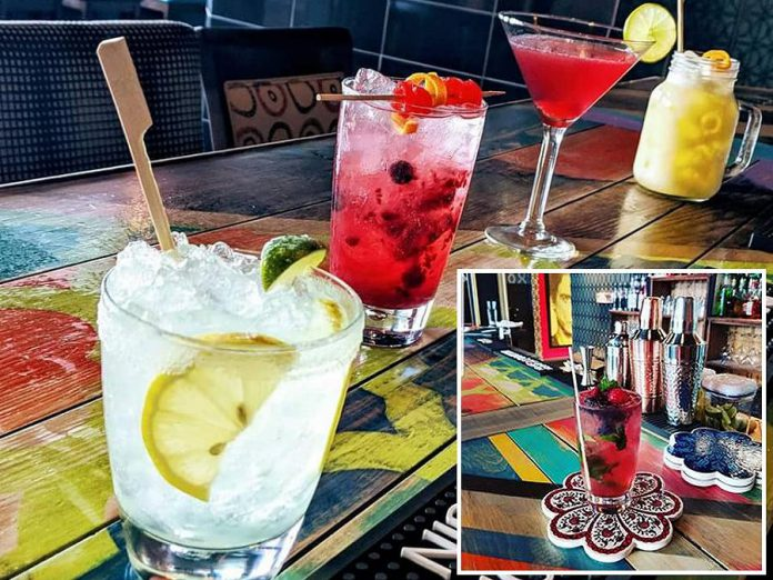 The Twisted Wheel in downtown Peterborough serves a variety of cocktails including the Twisted Berry Twist (inset), made with fresh blueberries and mint. (Photos: The Twisted Wheel)