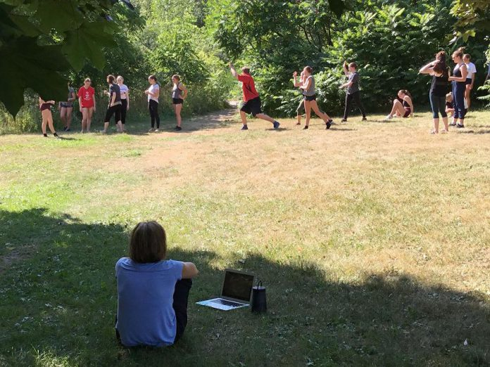 "Dancers rehearse on site at Rotary Park for ""One Earth"". (Photo courtesy of Blake Richardson)"