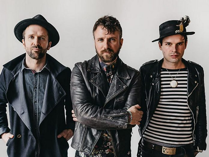 The Trews (pictured are founding members vocalist Colin MacDonald, guitarist John-Angus MacDonald, and bassist Jack Syperek) will be performing a free concert along with current drummer Chris Gormley and long-time touring keyboardist Jeff Heisholt at Peterborough Musicfest on Wednesday, July 4th at Del Crary Park. (Publicity photo)