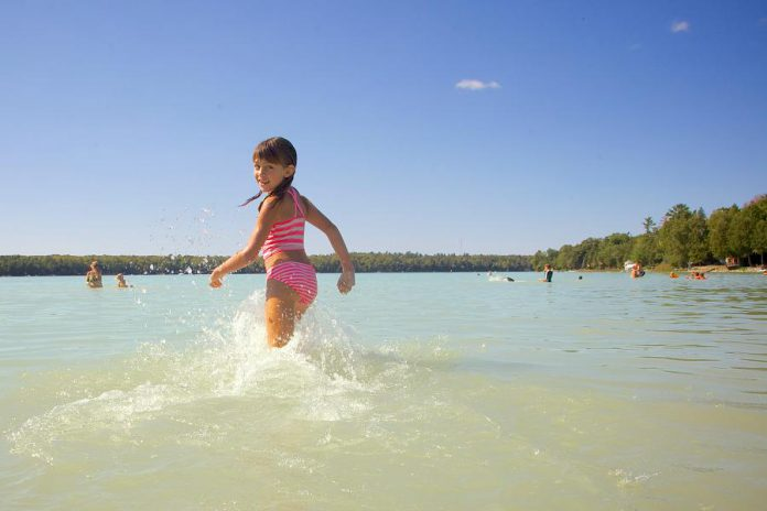 Sandy Beach in Trent Lakes is very popular among residents and visitors because of its soft sand extending into warm and shallow turquoise water. (Photo: Michael Hurcomb)