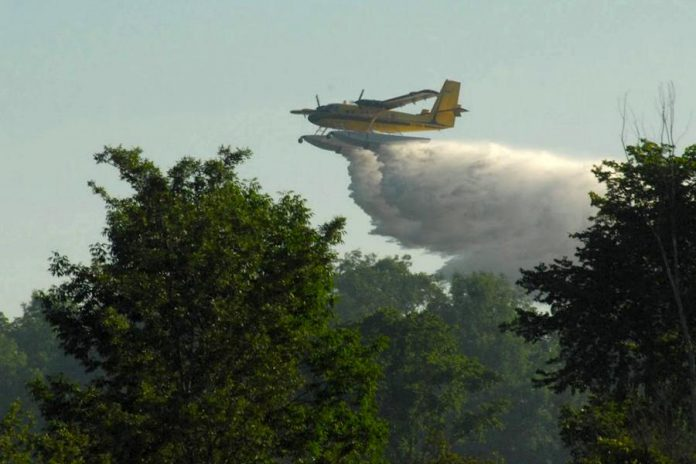Kawartha Lakes resident Dean Nighswander took this shot of an Ontario Ministry of Natural Resources and Forestry water bomber dropping its load on a brush fire north of Glenarm in the City of Kawartha Lakes on July 7, 2018. (Photo courtesy of Dean Nighswander)