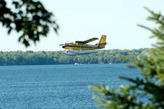 The water bomber comes in for a landing on Balsam Lake to scoop up water from the lake. (Photo courtesy of Dean Nighswander)