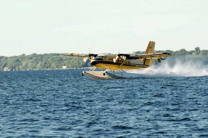 To fill its holding tanks, a water bomber skims along the surface for around 600 metres. (Photo courtesy of Dean Nighswander)