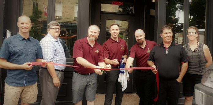 Cam Green and Rej Maranda (third and fourth from left) and Eric cut the ribbon officially opening The Thirsty Goose at 63 Walton Street in downtown Port Hope. Also pictured is Paul Mintha, Vice President of the Port Hope and District Chamber of Commerce, Councillor Terry Hickey, Martha Ciana of the Port Hope HBIA, and Councillor Jeff Lees.  (Photo: Port Hope and District Chamber of Commerce / Facebook)
