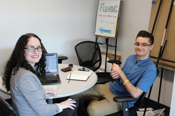 Young entrepreneur Dylan Trepanier of Alexander Optical (right) spent his summer in The Cube at the Innovation Cluster in the Slingshot program developing his business plan for an on-demand mobile eye examination clinic. He won $1,000 after pitching his idea to a panel of judges on August 24, 2018. (Photo courtesy of the Innovation Cluster)