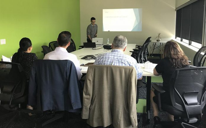 Dylan Trepanier of Alexander Optical makes his successful pitch to a panel of judges on August 24, 2018. (Photo courtesy of the Innovation Cluster)