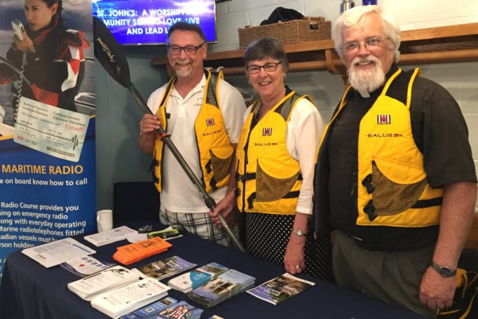 "Among its activities, the Peterborough Power and Sail Squadron does educational outreach in the community. Pictured are squadrom members at an awareness and information booth at St. John's Anglican Church in Lakefield in June, which featured a special ""Boaters Blessing"" service.  (Photo courtesy of Peterborough Power and Sail Squadron)"