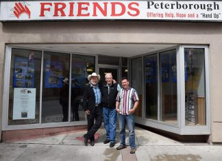Musician Washboard Hank, David Fisher, and musician Pete Gauthier in front of FRIENDS Peterborough at 283 George Street North in downtown Peterborough. The two musicians have organized a benefit concert on Sunday, August 26th at Del Crary Park to raise funds for FRIENDS Peterborough, a Christian-based agency that provides support and assistance for people who are homeless or marginalized. (Photo: Markus Maar)