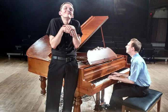 """Victor Pokinko, shown here performing as Dahlia Whitney, plays all the characters in """"Murder for Two"""" except for Officer Marcus, performed by Matt Pilipiak (right). Using a piano previously owned by theatrical legend Colm Wilksinon, the two actors also perform all the songs in the musical comedy. (Photo: Sam Tweedle / kawarthaNOW.com)"""