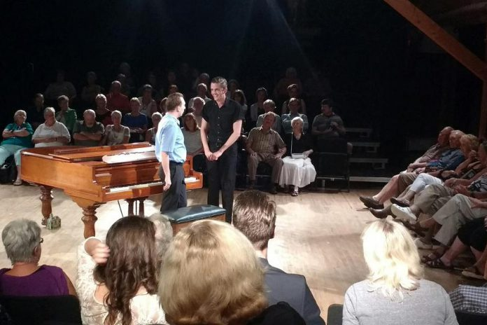 """""""Murder for Two"""" is performed in the round, with its only set piece and prop a grand piano previously owned by theatrical legend Colm Wilksinon. (Photo: Sam Tweedle / kawarthaNOW.com)"""