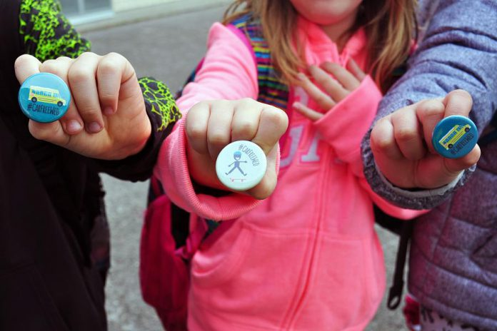 Kids show off their Car Free Wednesday buttons that were handed out last year at all schools participating in the program. Car Free Wednesdays encourages students to walk, bike, scoot or bus to school each Wednesday of the school year. (Supplied photo)