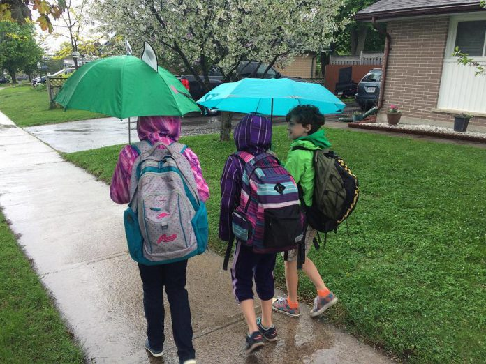 Planning ahead for the weather means that a walk, bike, or scooter ride to school can be fun for kids! Students who use active means to get to school report that they feel good after their trip to school, that they enjoy meeting up with friends along the way, and engaging in the community. (Supplied photo)