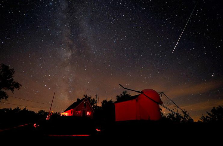 A Perseid meteor streaking down the sky in 2010 in Springfield, Vermont. This year's meteor shower will peak overnight on Sunday, August 12, 2018. (Photo: Dennis di Cicco / Sky & Telescope)