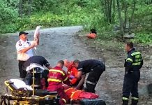 Barry Killen captured this scene of a rescue in Kawartha Highlands Provincial Park of a camper who was injured when a piece of equipment containing flammable liquid exploded at her remote campsite on Shark Lake. The woman, who suffered burns to areas of her body, was later airlifted by helicopter to Peterborough Regional Health Centre. (Photo: Barry Killen)