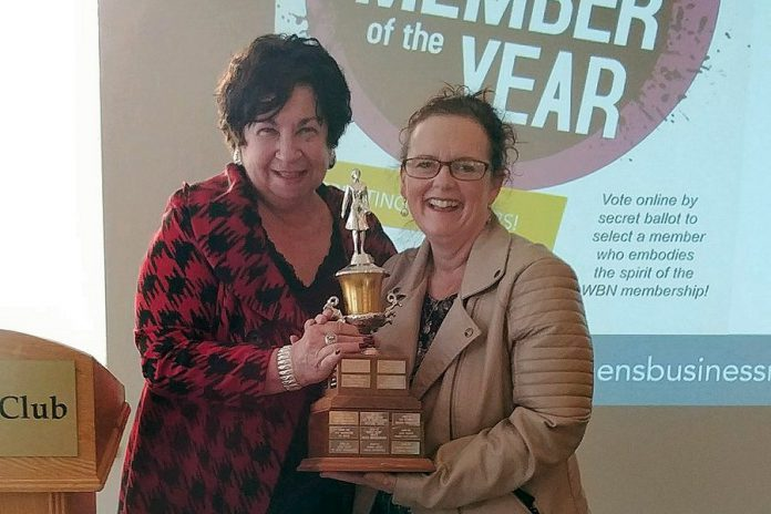 "Maureen Tavener presents a ""keeper version"" of the 2018 Member of the Year Award to Tracey Ormond at the May 2018 meeting of the Women's Business Network of Peterborough. (Photo: Paula Kehoe / WBN)"