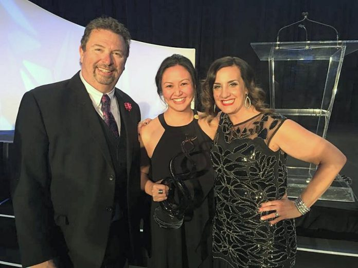 Grace Reynolds (centre) with her Best Newcomer Agent award at the Mortgage Awards of Excellence in May 2018. Also pictured are two of the head team members from Verico Financial Group Inc., the top mortgage broker network in Canada, of which Grace is a member. (Supplied photo)