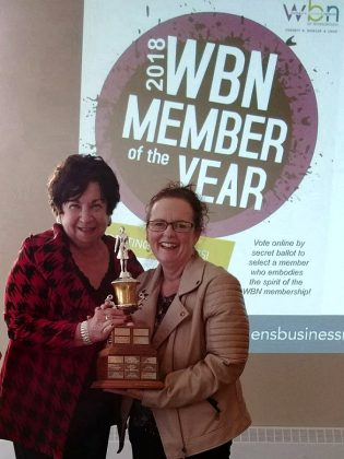 """Before being elected as  2018-19 President of the Women's Business Network of Peterborough, Tracey Ormond was also voted the 2018 WBN Member of the Year. Here she accepts a """"keeper version"""" of the award from Maureen Tavener at the organization's May 2018 meeting. (Photo: Paula Kehoe / WBN)"""