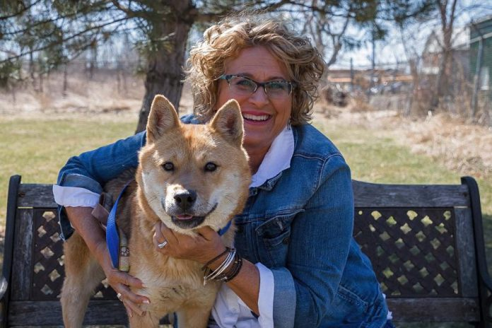 Susan with one of 15 dogs rescued from a Korean meat farm by Humane Society International and then made available for adoption. (Photo: Heather Doughty)