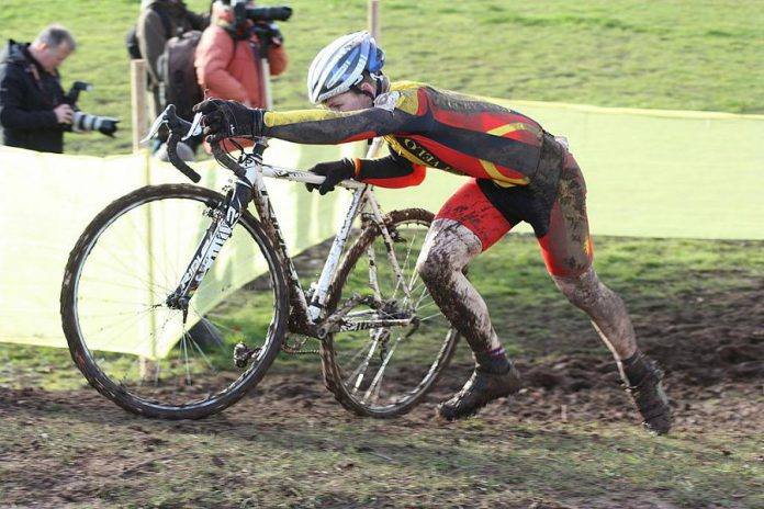 A cyclist navigates an obstacle during a cyclocross race in Abergavenny, Wales. A cyclocross course consists of many short laps on a course featuring pavement, wooded trails, grass, steep hills, and obstacles. Peterborough is hosting the Canadian championships in 2018 and again in 2019. (Photo: Ray Tyler / Flickr)